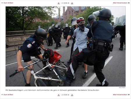 """Screenshot Spiegel Online, Bildunterschrift: """"Mit Baseballschlägern und Hämmern zertrümmerten die ganz in Schwarz gekleideten Randalierer Schaufenster."""""""